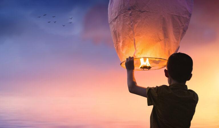 boy letting go of lantern